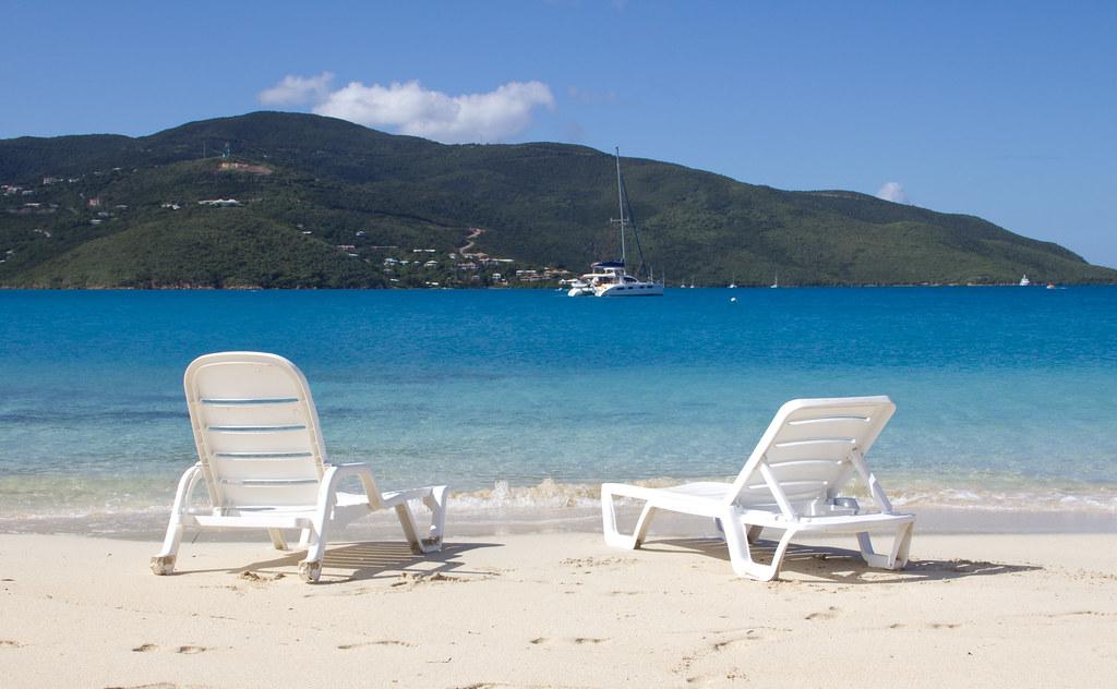 white lounge chair on tropical beach