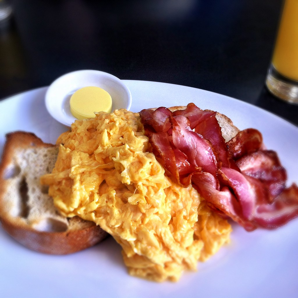 Scrambled eggs on toast with bacon at Speakeasy | Best ...