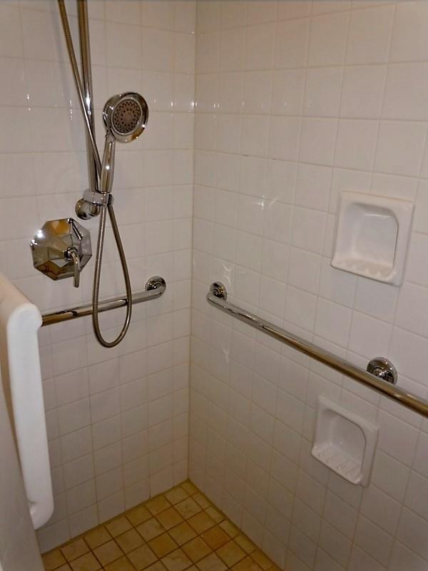 Height adjustable hand-held shower head   AUCD   Flickr