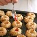 Making jam almond thumbprint cookies
