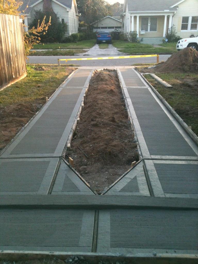 Ribbon concrete driveway for Cement driveway ideas