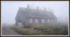 Stone house in the fog