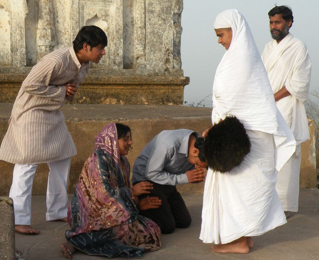 Jain nun | Pilgrims falling to the ground in front of a ...
