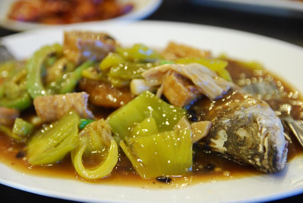 Fried Barramundi with tofu, salted mustard green, bitter m ...