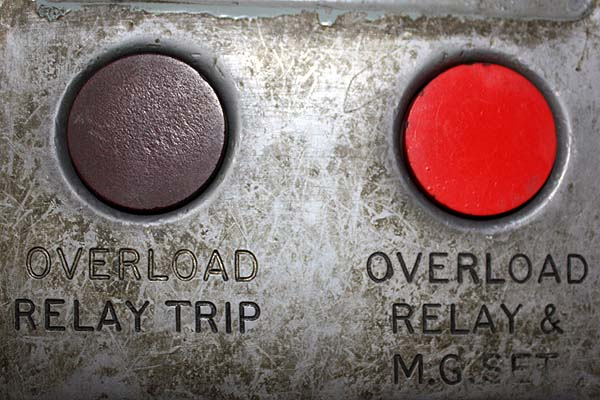 "A picture of two buttons, the first labeled ""Overload Relay Trip and the second labeled ""Overload Relay & M.G. Set"