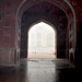 Looking at the Taj Mahal through the arches