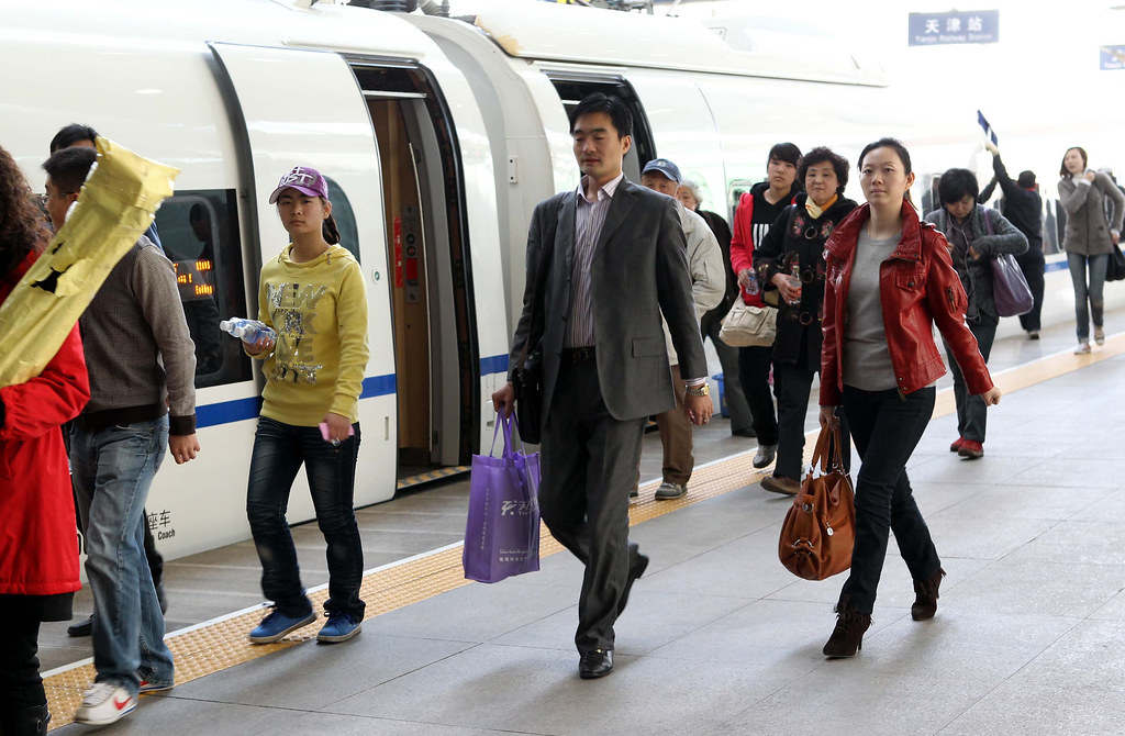 A busy train station platform in Tianjin
