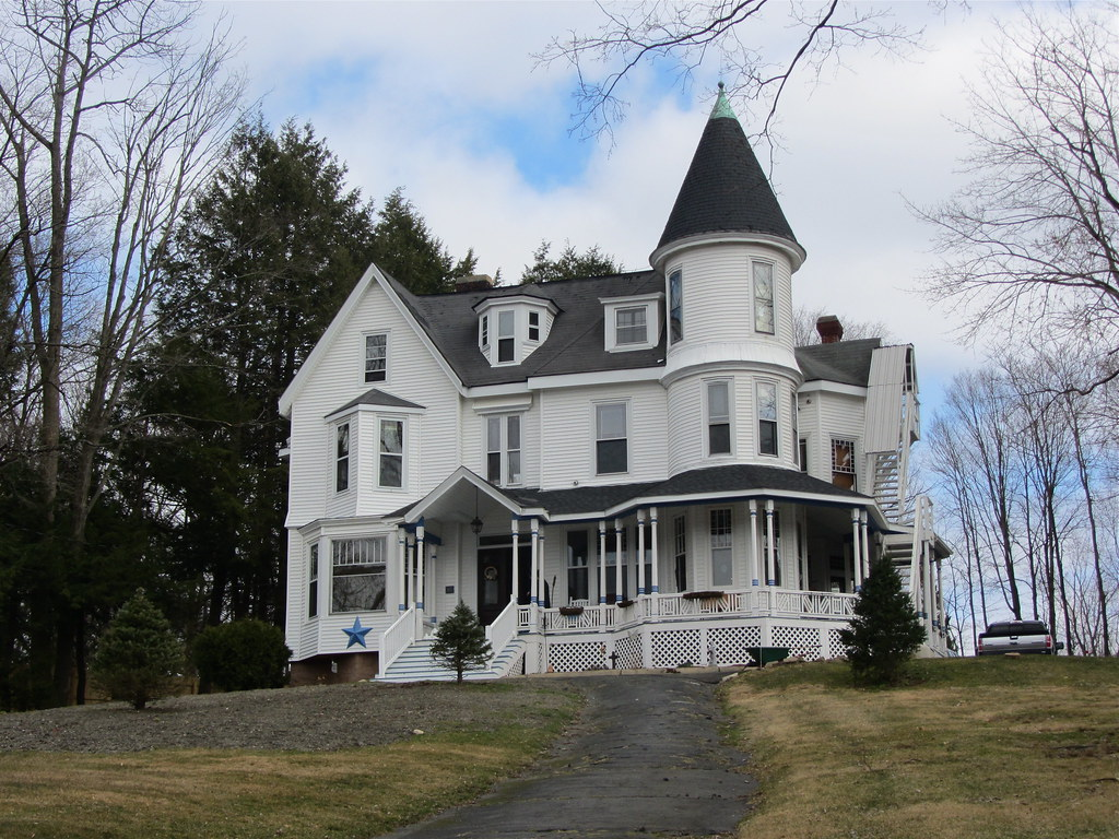White house with a tower on a hill amy boemig flickr for Homes with towers