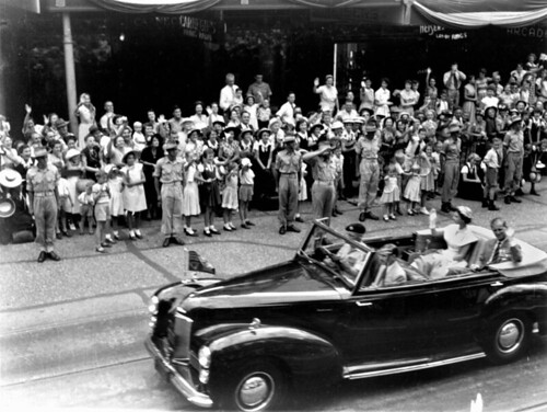 Queen Elizabeth II and the Duke of Edinburgh travel along Queen Street, Brisbane, on the last day of their Queensland tour in 1954 | by State Library of Queensland, Australia