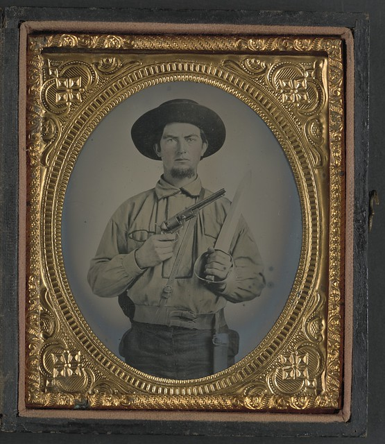 Unidentified Soldier In Confederate Uniform With Colt