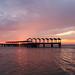 Sunset on fisherman's pier at Jekyll Island, across from St. Simons Island, GA