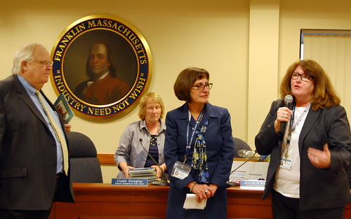 Asst. Superintendent Sally Winslow (center) recognized by Chair Kevin O'Malley (left) and Superintendent Maureen Sabolinksi (right) (School Committee person Cindy Douglas in background)