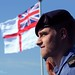Royal Navy Sailor in Front of the White Ensign