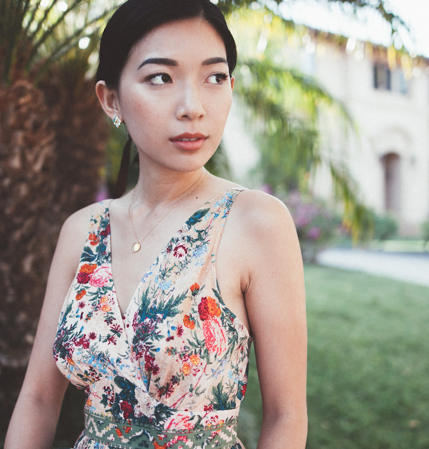 Stephanie Liu of Honey & Silk wearing Plenty by Tracy Reese Jumpsuit and Marida Jewelry