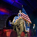 Here comes the elephant with Old Glory