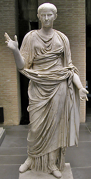 c0331a10e A full-length statue of a woman with her arms open (in pra