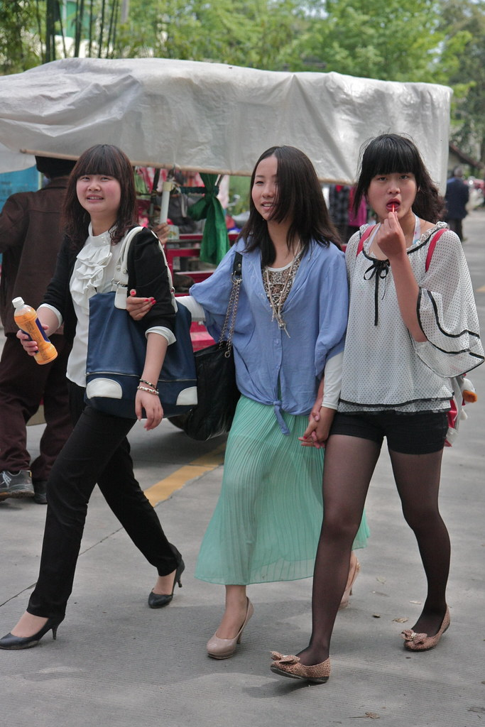 Young Chinese Girls At A Street Market Outside Of Rural Ma