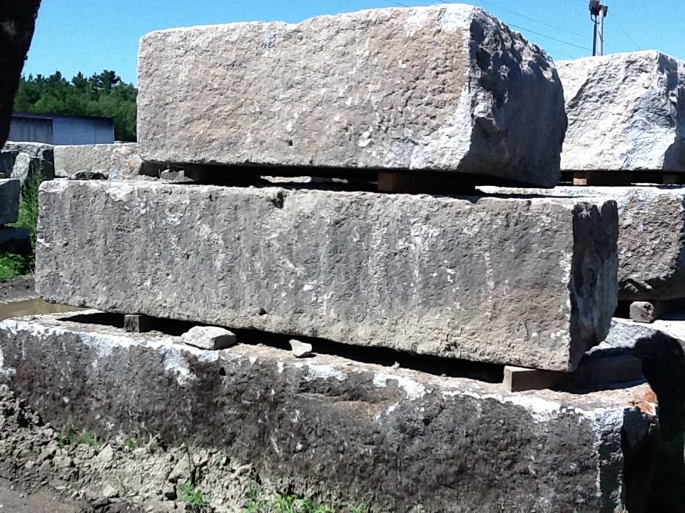 Granite Block Seawall : Reclaimed granite pier block blocks