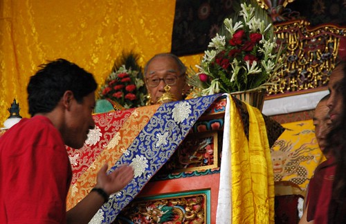 HH Dagchen Rinpoche overseeing the long life initation from his throne, a Tibetan man requests the blessing, two monks, Sakya Lamdre, Tharlam Monastery stage, Boudha, Kathmandu, Nepal | by Wonderlane