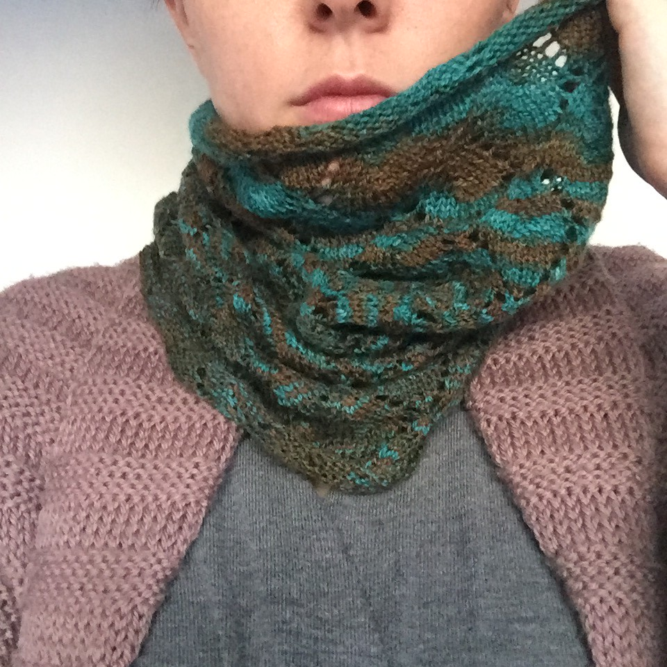whorl cowl in handpainted lace weight yarn in teal and brown colourway