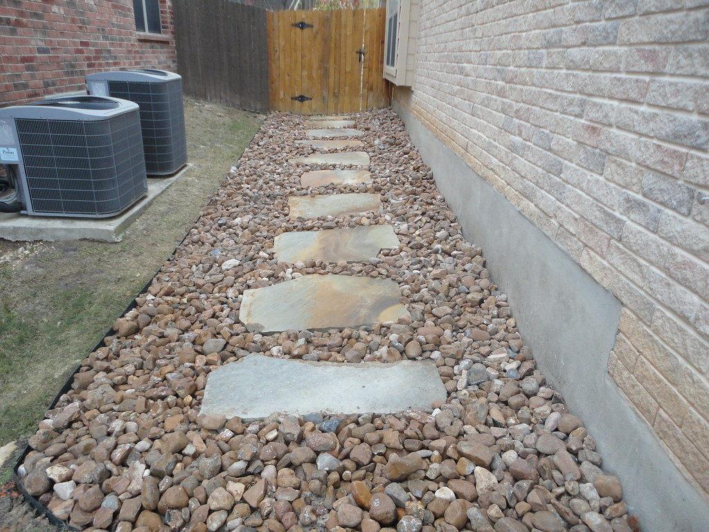 flagstone walkway set in river rock 2 designs completed
