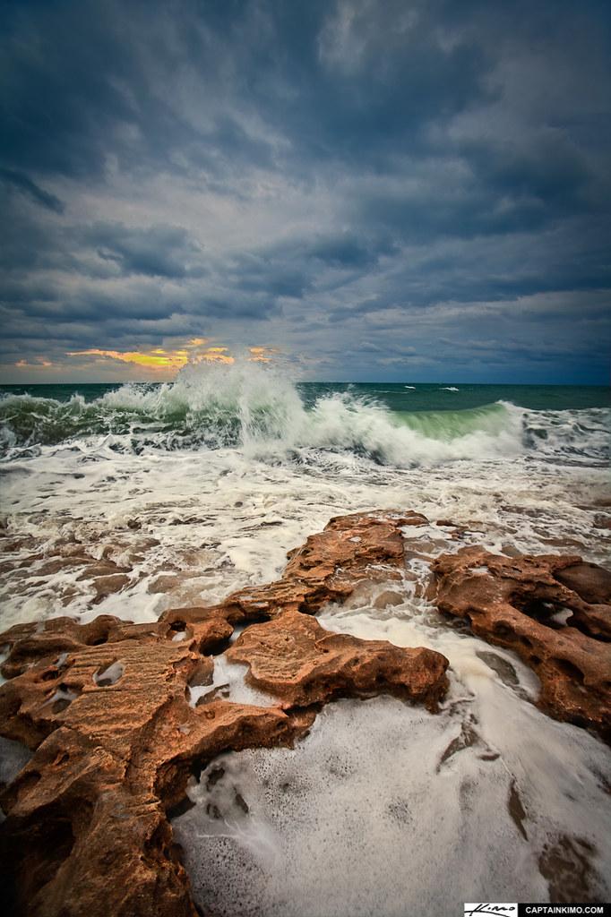 wave breaking shore jupiter beach florida