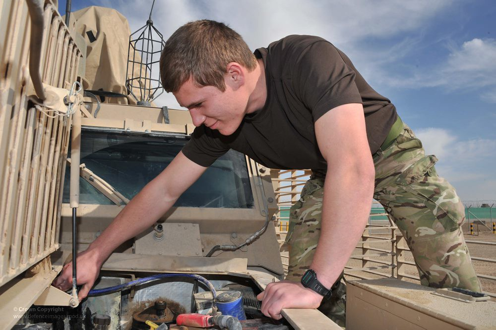 reme mechanic maintaining a mastiff armoured patrol vehicl