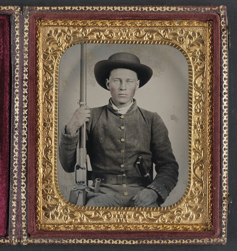 Unidentified Soldier In Confederate Uniform With Colt Rev