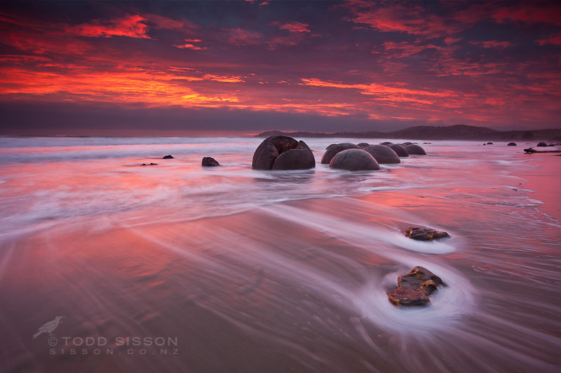 Sunrise moeraki boulders new zealand another magnificent for Landscape jobs nz