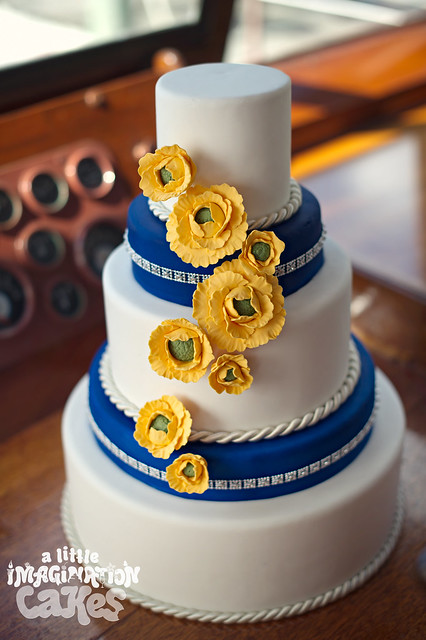 Nautical Wedding Cake With Yellow Ranunculus And Rope Trim