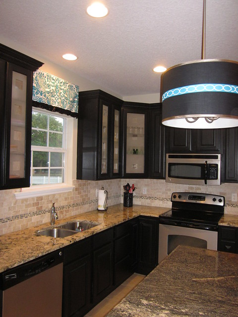black kitchen cabinets, frosted glass cabinet doors ...