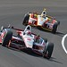 Ryan Briscoe in front of Helio Castroneves