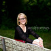 High school senior girl in black glasses on park bench in hendersonville tn