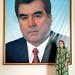 Tajik woman and Tajik President's portrait