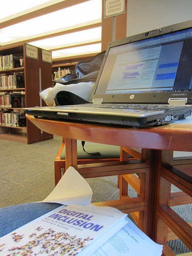 reading about digital inclusion while surrounded by digital inclusion at Hennepin County Public Library (MN) | by TechSoup for Libraries