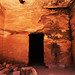 """Mar 12 - Inside the """"Garden hall"""" tomb with ancient pictographs of people and animals on the walls, Petra"""
