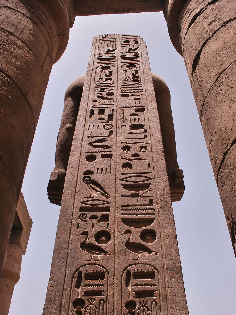 Luxor temple hieroglyphics on rear of statue helen for Architecture design company in egypt