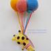 Giraffe and balloons