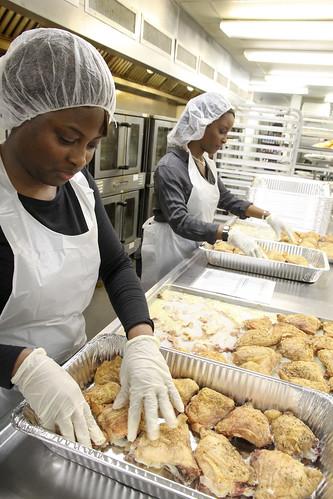 Nina Crawford (left) and Nakisha Harris (right) volunteering at DC Central Kitchen