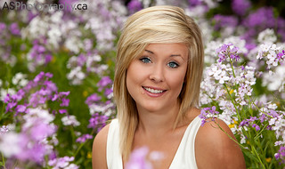 spectacularly cute young blonde woman in a field of flowers | by andreas_schneider