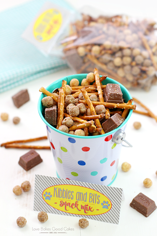 Kibbles & Bits Snack Mix in a small tin pail.