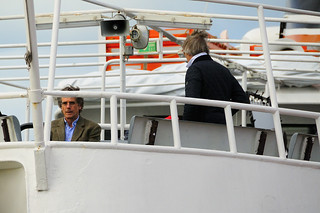 Actor Jeremy Irons and Director Bille August on the ferryboat on the Tagus River for another scene of the film Night Train to Lisbon at the Belém Ferry Terminal in Lisbon, Portugal. | by Visit Portugal