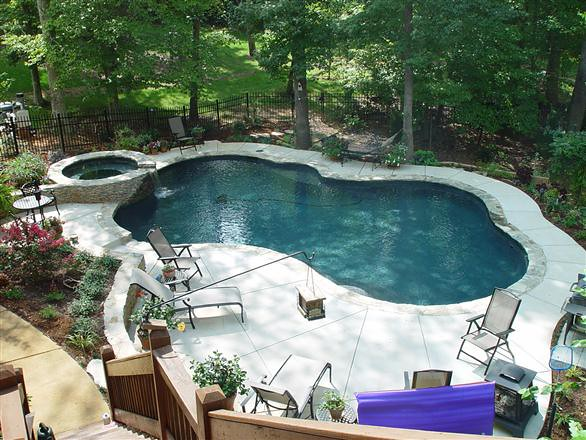 Pool into steep slope poolbydesign flickr for Pool design sloped yard