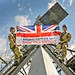 Personnel at RAF Digby Flying the Armed Forces Day Flag