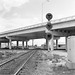 SCL mainline (former SAL) view to the south of the former ACL - SAL diamond under the U.S. 92 overpass with a typical SAL triple light block signal at Auburndale, Florida, mid 1970's