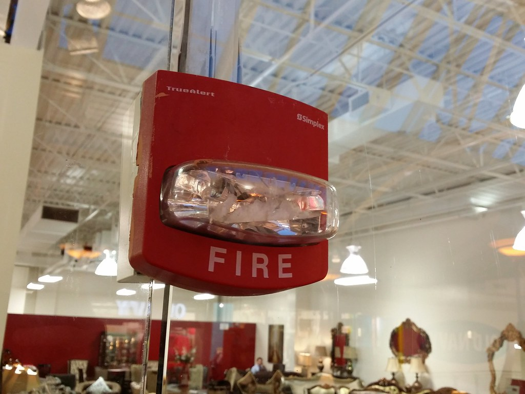 Fire Alarm Strobe Mounted Through A Glass Window A