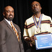 Keion Clinton, recipient of the SUNY Chancellor's Award for Excellence in Teaching, with Dr. Quintin Bullock, President of SCCC