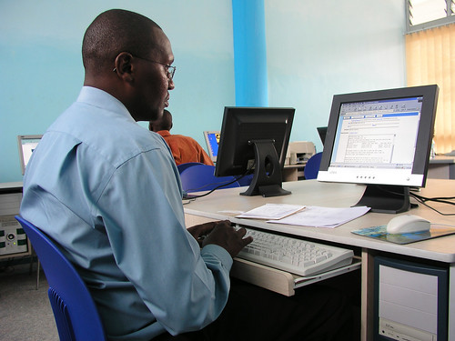Using a computer in an internet cafe | by World Bank Photo Collection