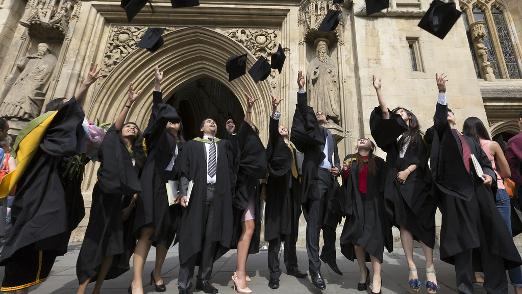 Students celebrate graduation at Bath Abbey