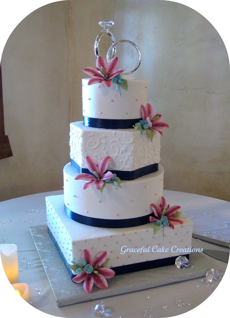 pink blue and white wedding cakes white wedding cake with pink stargazers and blue s 18569